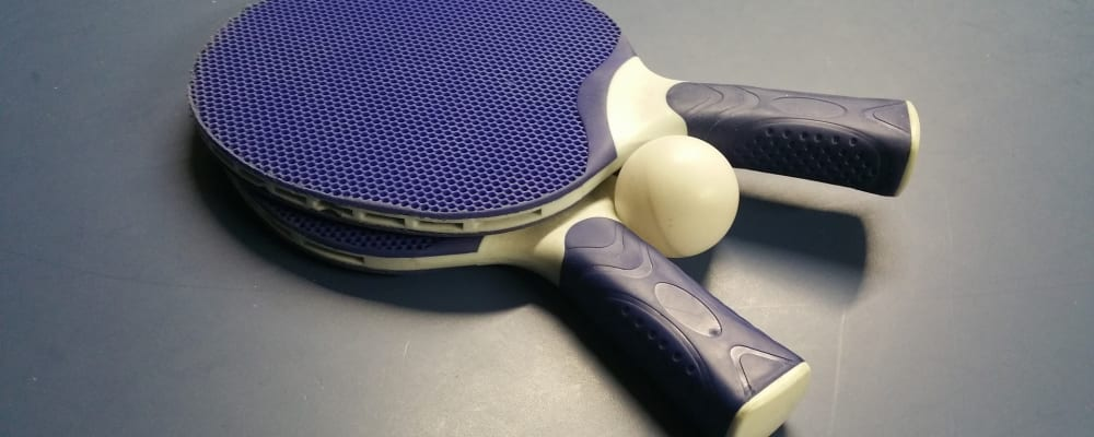 image of table tennis bats and ball